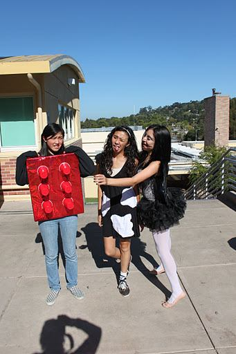 Three Carlmont students showing off their costumes