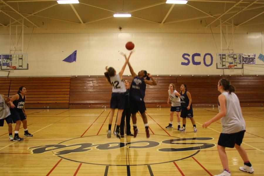Sabrina+Miller+and+Anisa+Smith+jump+for+the+ball+during+a+scrimmage.+