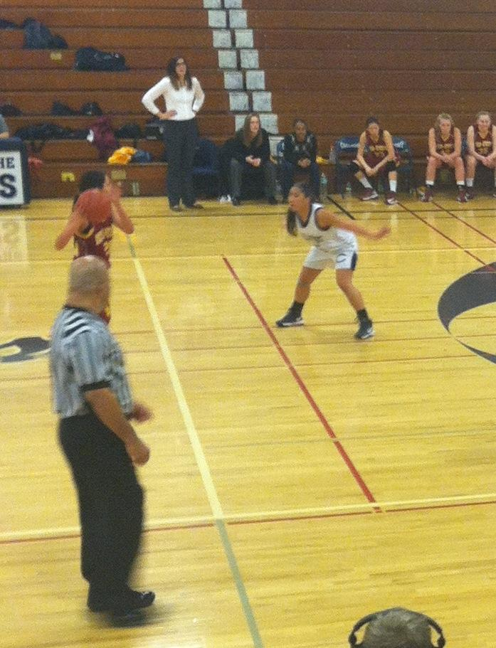 Lum stands guard on defense at MA pointguard looks to pass
