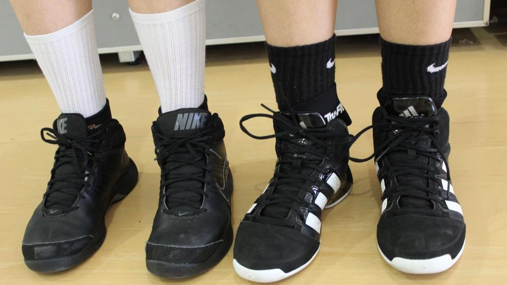 Caslow%27s+basketball+players+wear+compression+sleeves+on+their+ankles+to+prevent+running+injuries+before+they+occur.