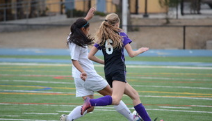Manzanares fighting for the ball against Sequoia high school.