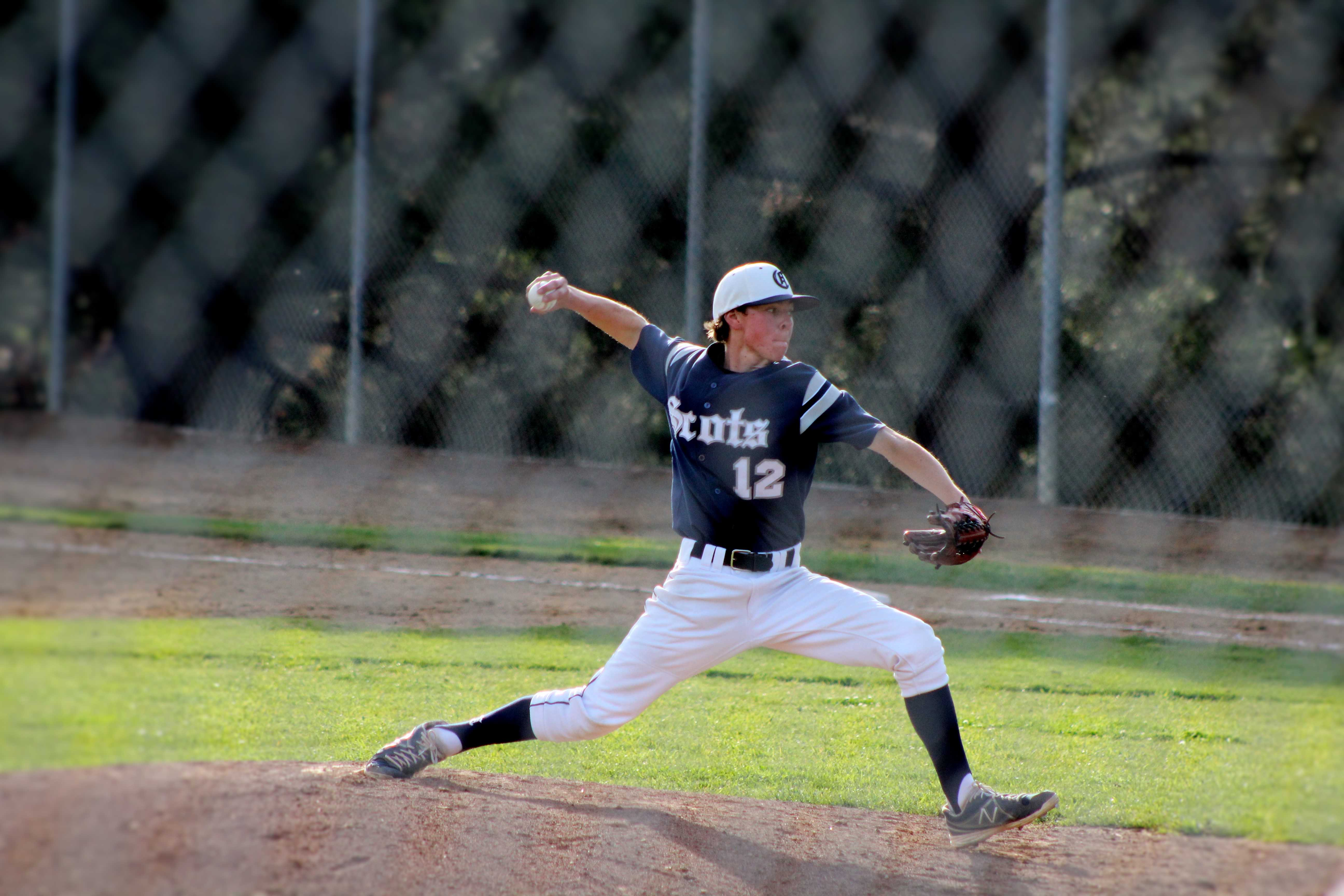 Pitcher Ryan Giberton throwing a strike for the second out of the inning.