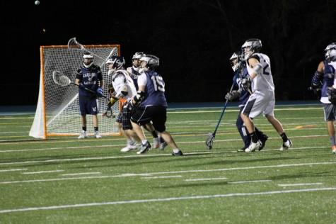 The boys varsity lacrosse team practices