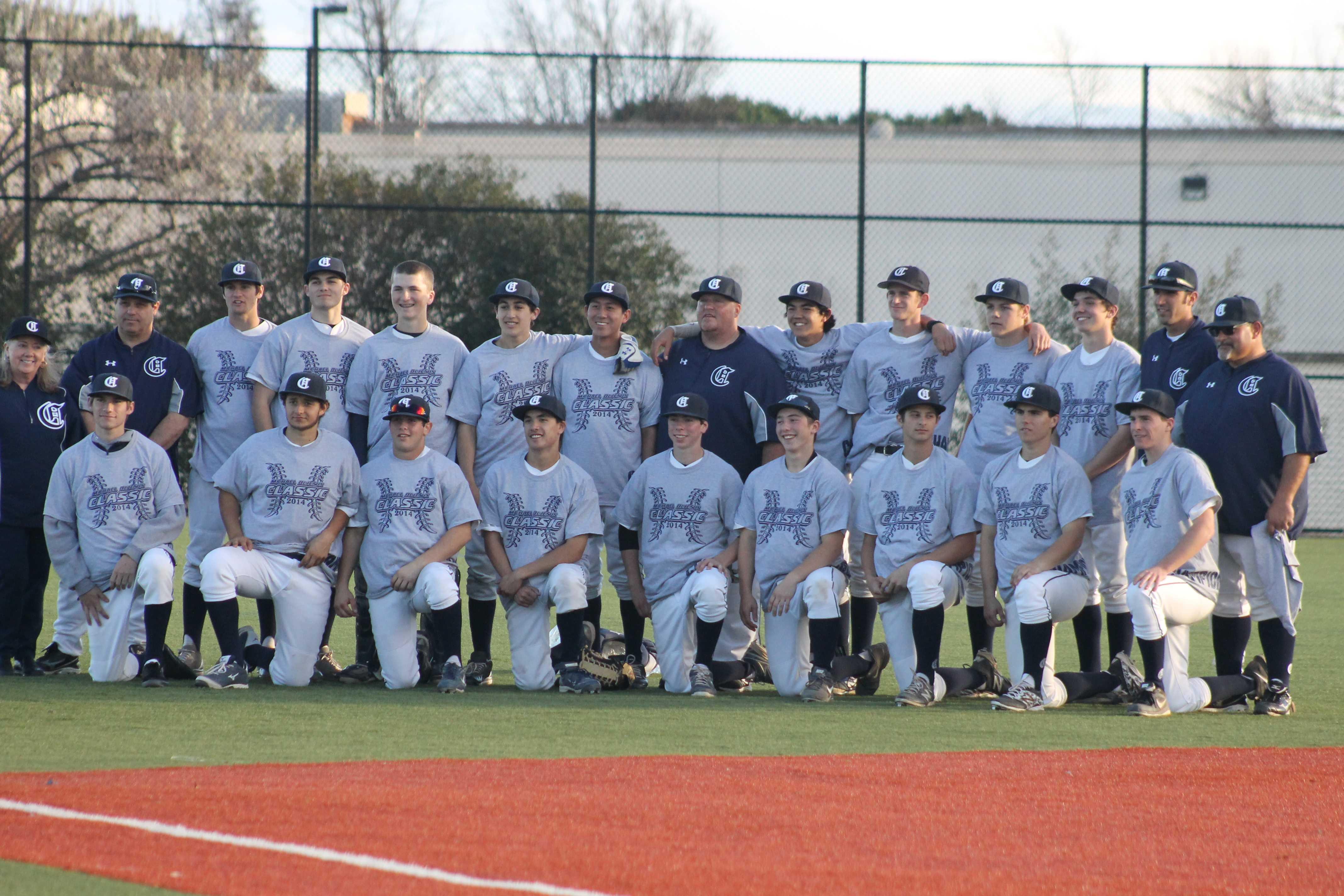 Varsity baseball poses after winning championship game.