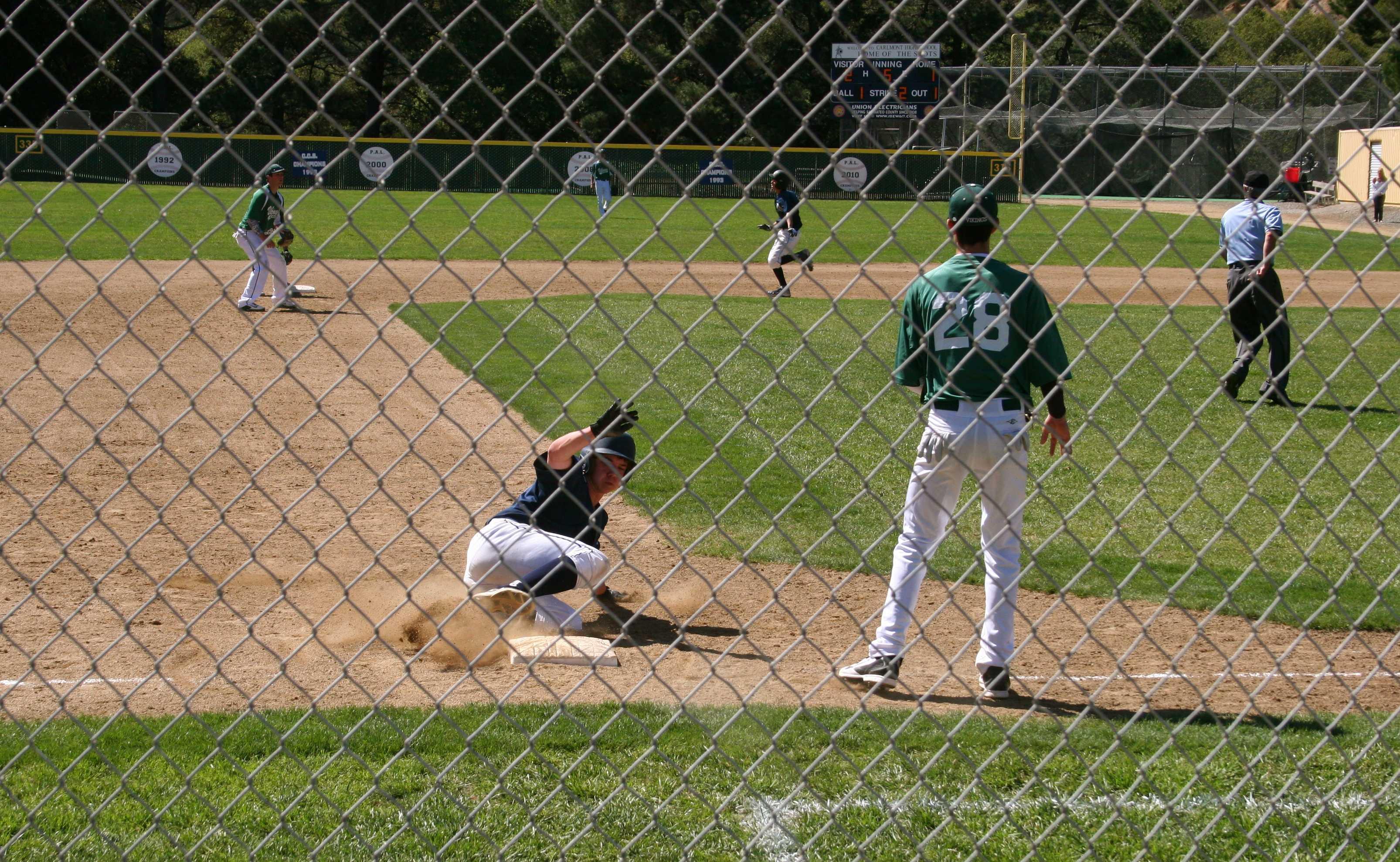 Third baseman Michael McGill steals third base.