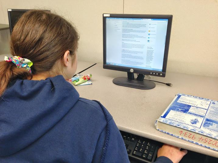 Senior Josephine Kraemer researches in the tutoring center after school.