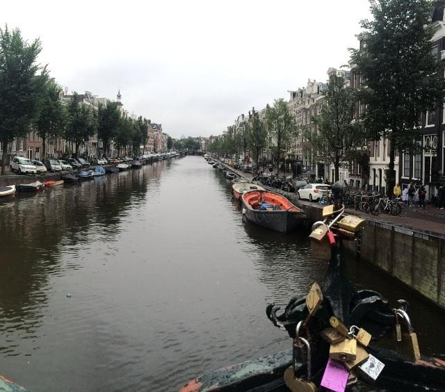 One of the canals in the famous city of Amsterdam.
