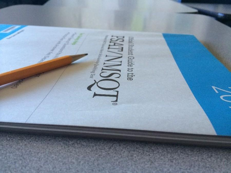 Complimentary+practice+booklets+are+handed+out+to+students+to+help+prepare+for+the+PSAT+