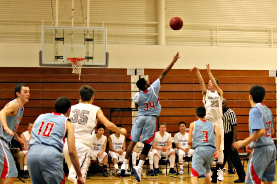 Junior Andrew Carlsen sinking a 3-pointer in the game against Hillsdale.