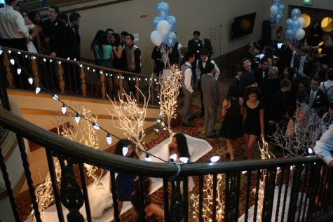 Students wait in the lobby before the dance for the coat-check and pictures.