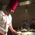 At Benihana, guests patiently watch as their chef cooks their food on the grill right in front of them.