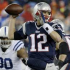 Tom Brady steps back in the pocket and gets prepared to throw