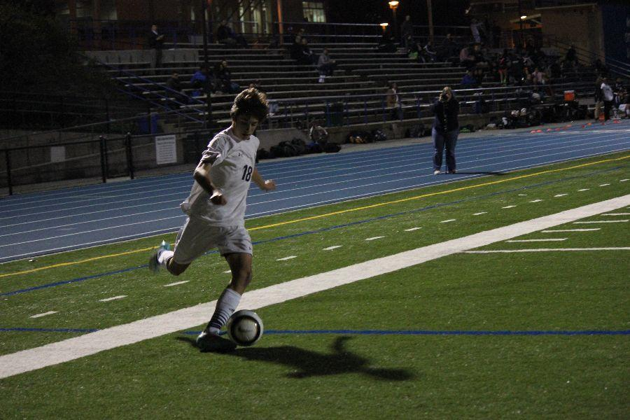 As+he+sprints+down+the+sideline%2C+sophomore+Diego+Rodriguez+turns+his+body+to+cross+the+ball+to+his+teammate%2C+resulting+in+a+goal+to+take+the+lead.