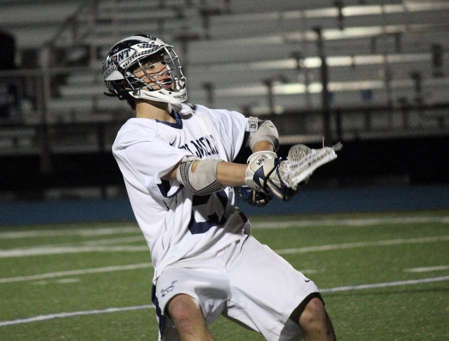Senior+Shelby+Rebholtz+propels+himself+into+his+shot+as+he+aims+for+the+lower+corner+of+the+goal.