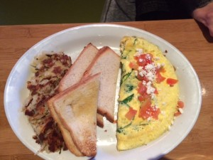 The spinach and salsa topped omelet was tastefully presented.