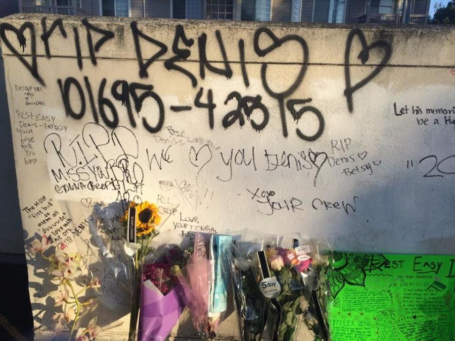 Meshchyshyn%27s+friends+and+family+write+heartfelt+messages+on+the+wall+of+the+parking+lot+where+he+was+stabbed.+
