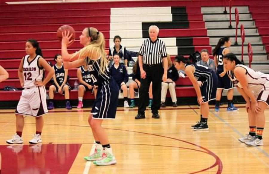 Sophomore+Megan+Olazar+in+a+varsity+basketball+game.