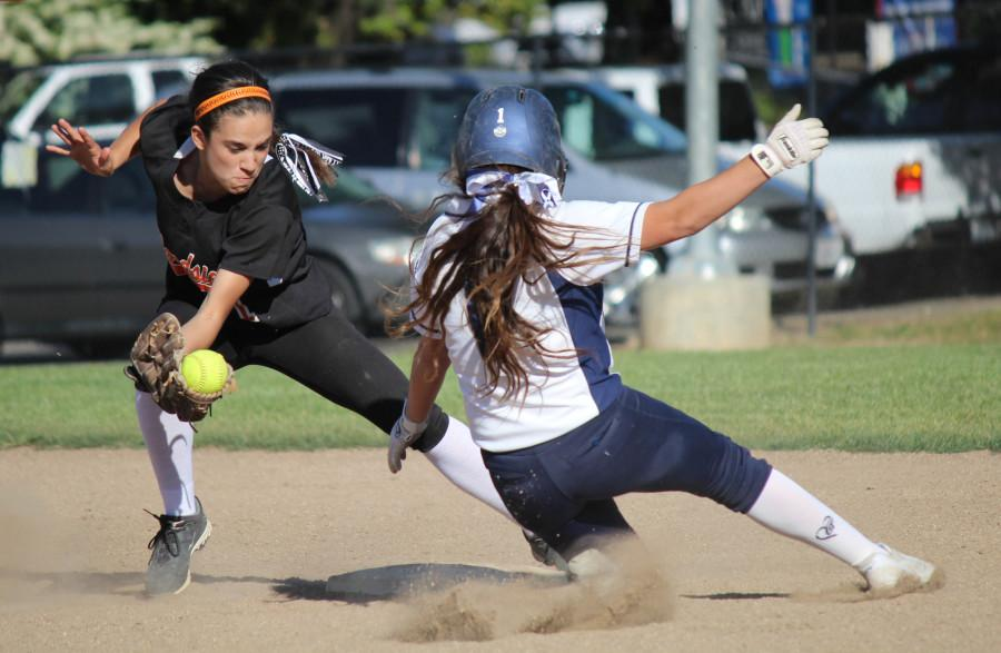 Sophomore+Raquel+Gandolfo+slides+into+second+base+for+a+steal+as+she+outruns+the+catcher%27s+throw.