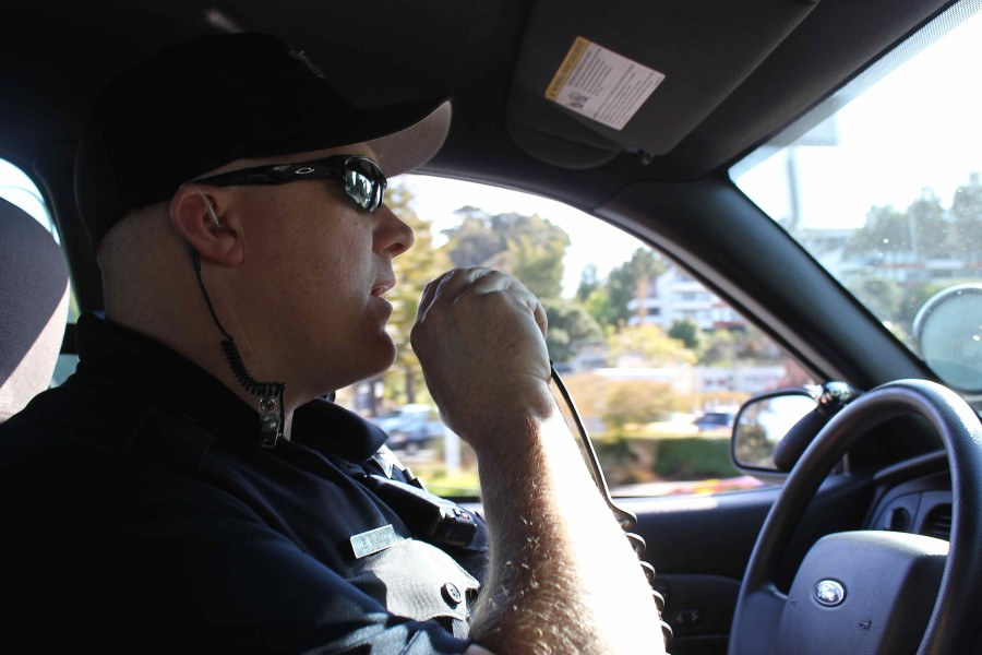 Officer+Brian+Vogel%2C+while+patrolling+on+a+ride-along%2C+responds+to+another+officer%27s+call.+