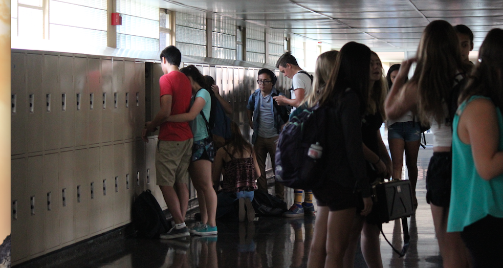During the power outage, students congregate in the dark hall.