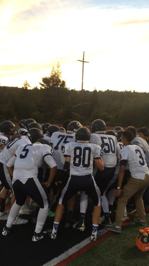 Carlmont+Scots+huddle+together+before+they+charge+onto+the+field.