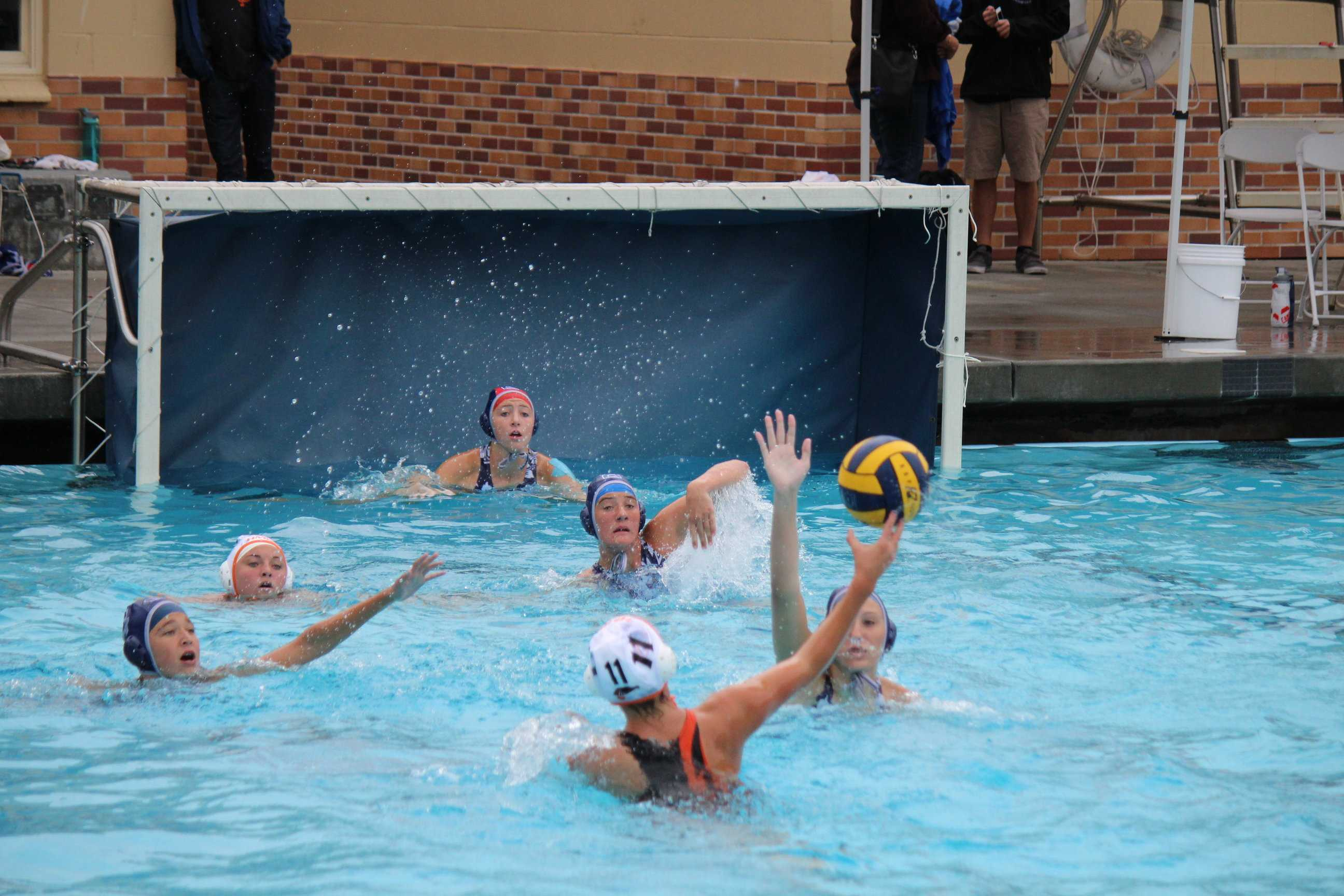 Carlmont's goalkeeper Izzy de Wood prepares to block the shot of Half Moon Bay's Carly Hilvedi.