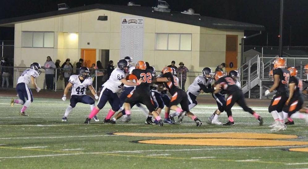 The Scots and Bearcats clash under the lights. In the end, the Scots' spirit was not enough to overcome the Bearcats' strong defensive line.
