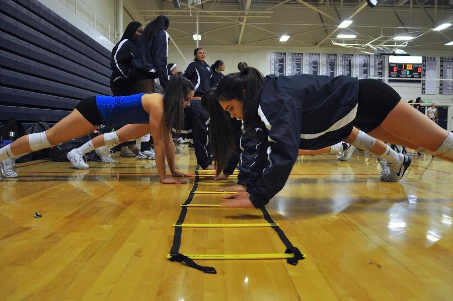 Junior+Sarah+Smith+does+push-ups+to+warm-up+before+their+game+against+Mills.