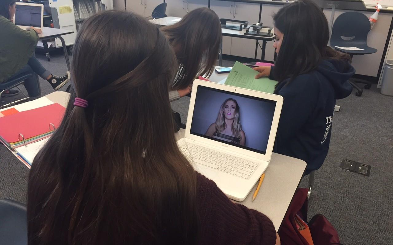 A student watches the world trending controversial YouTube video titled,