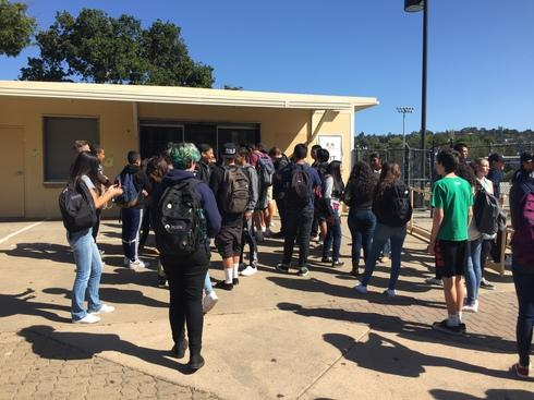 A crowd of students gathers to buy lunch right after the bell rings.
