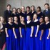 Genevieve Tep, director of Carlmont choirs, stands with the 15 chosen singers for this year's California Coastal Honor Choir.