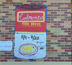 A poster imitating Campbell's Soup hangs on Carlmont campus to urge students to donate to the food drive.