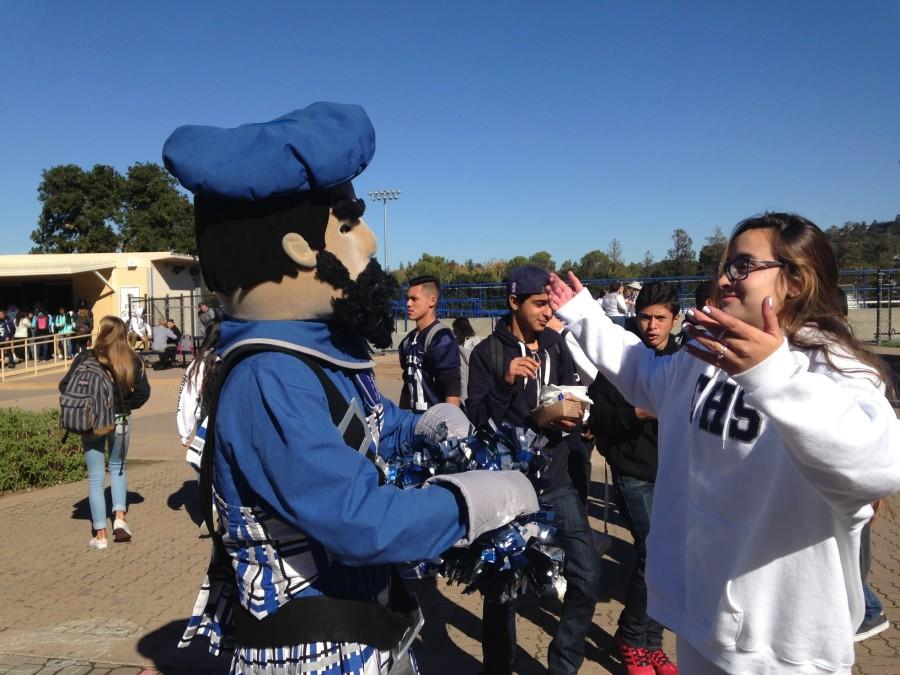 Junior+Tori+Miranda+shows+her+school+spirit+with+Carlmont+mascot+Monty.