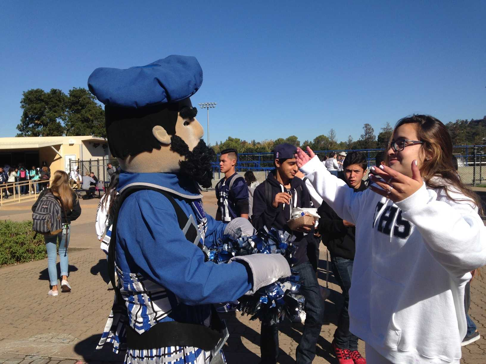 Junior Tori Miranda shows her school spirit with Carlmont mascot Monty.