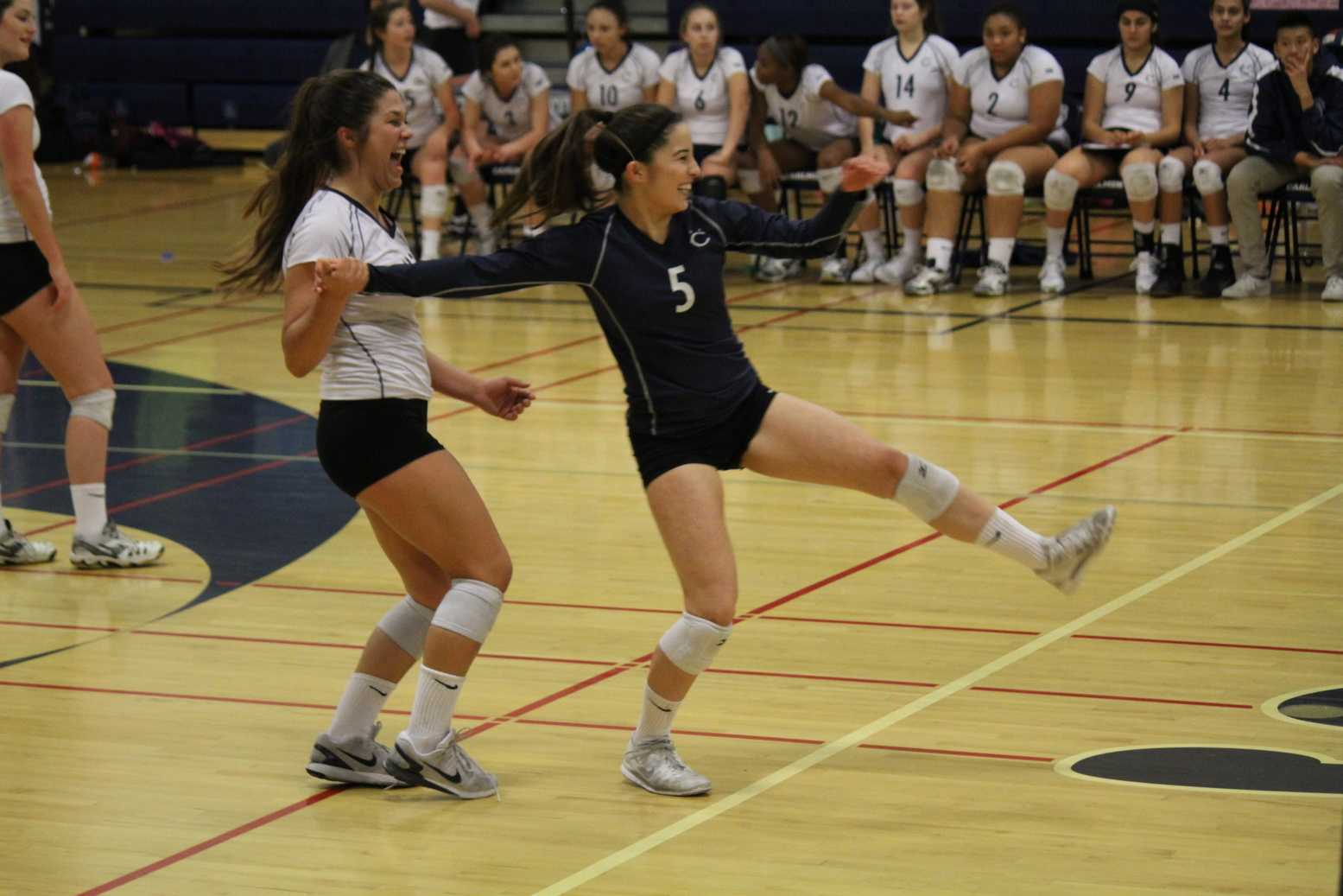 Seniors Erin Alonso and Elena Mateus celebrate their victory against the Sequoia Cherokees on senior night.