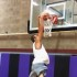 Sophomore Jacob Lloyd dunks the ball at practice.