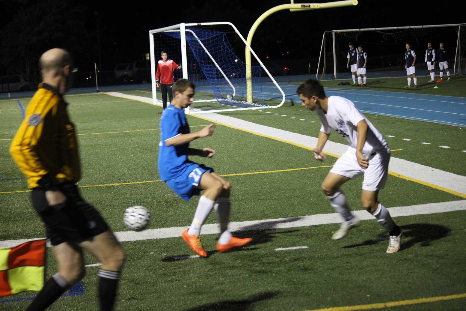 Sophomore Noah Sanchez trying to play the ball out of the corner and past the defender.