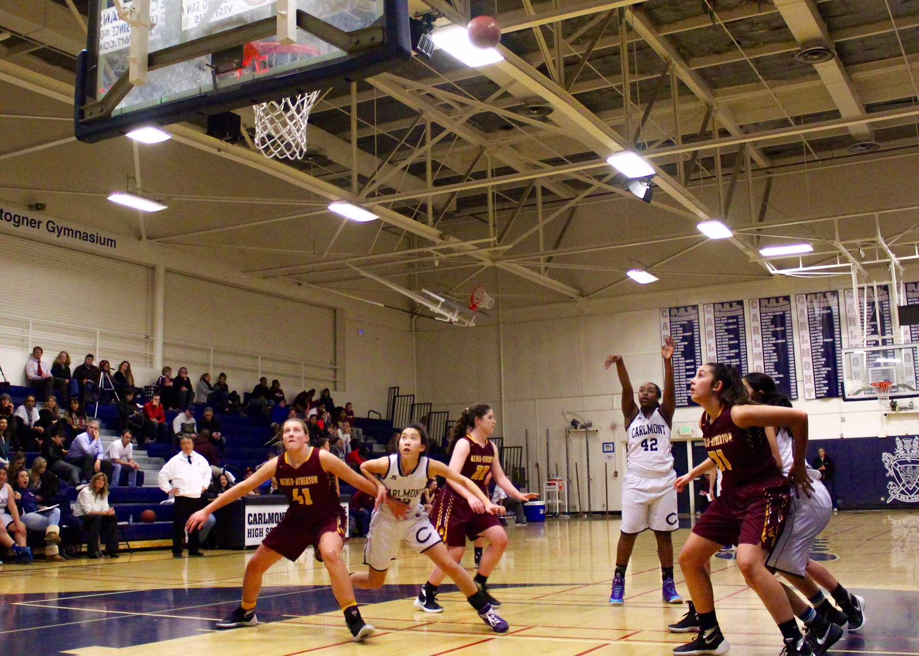 Carlmont's center Alyssa Hayes takes a free throw after getting fouled during a drive to the basket.