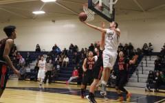 Boys varsity basketball wins in double overtime