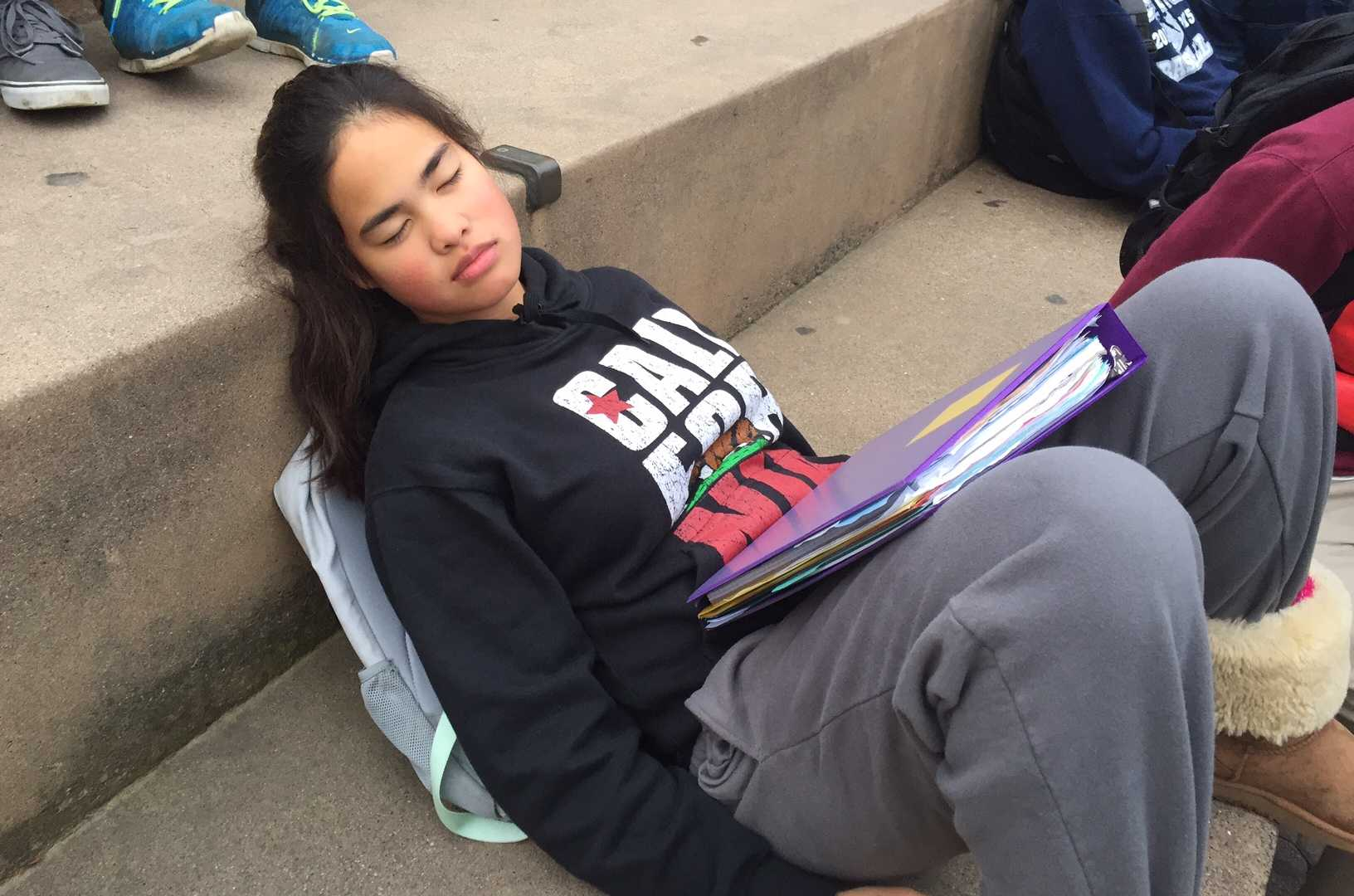 Sophomore Tyrese Lopez tries to catch up on sleep in the quad after a long night of doing homework.