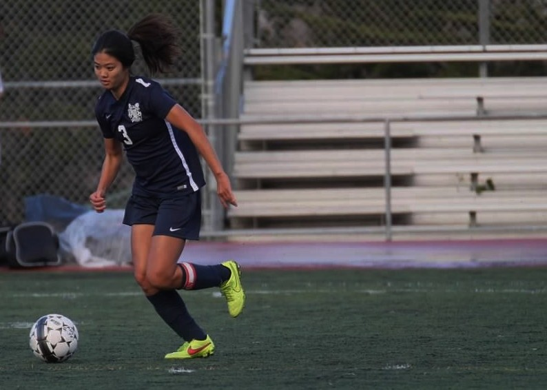 Team captain senior Kayla Fong dribbles downfield to press for another attempt on goal.