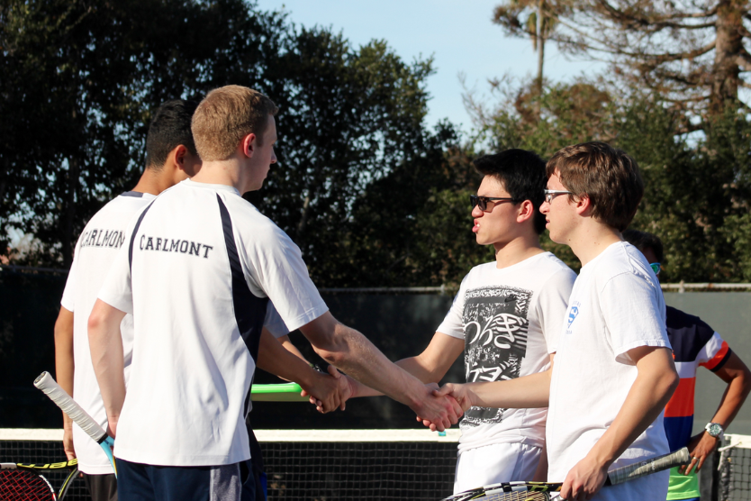 Seniors+Bobby+Goldie+and+Josh+Pogue+shake+hands+with+their+opponents.