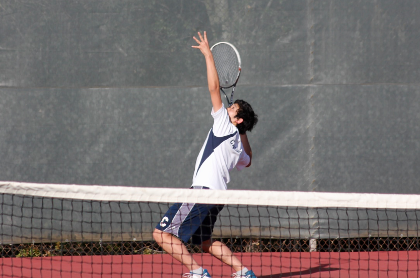 Senior+Alex+Yang+balances+himself+to+smash+the+tennis+ball.