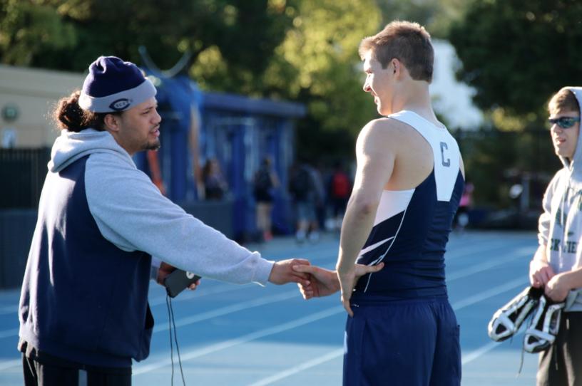 Coach+Lou+Schuman+congratulates+sophomore+Jason+Lloyd+on+a+victory.