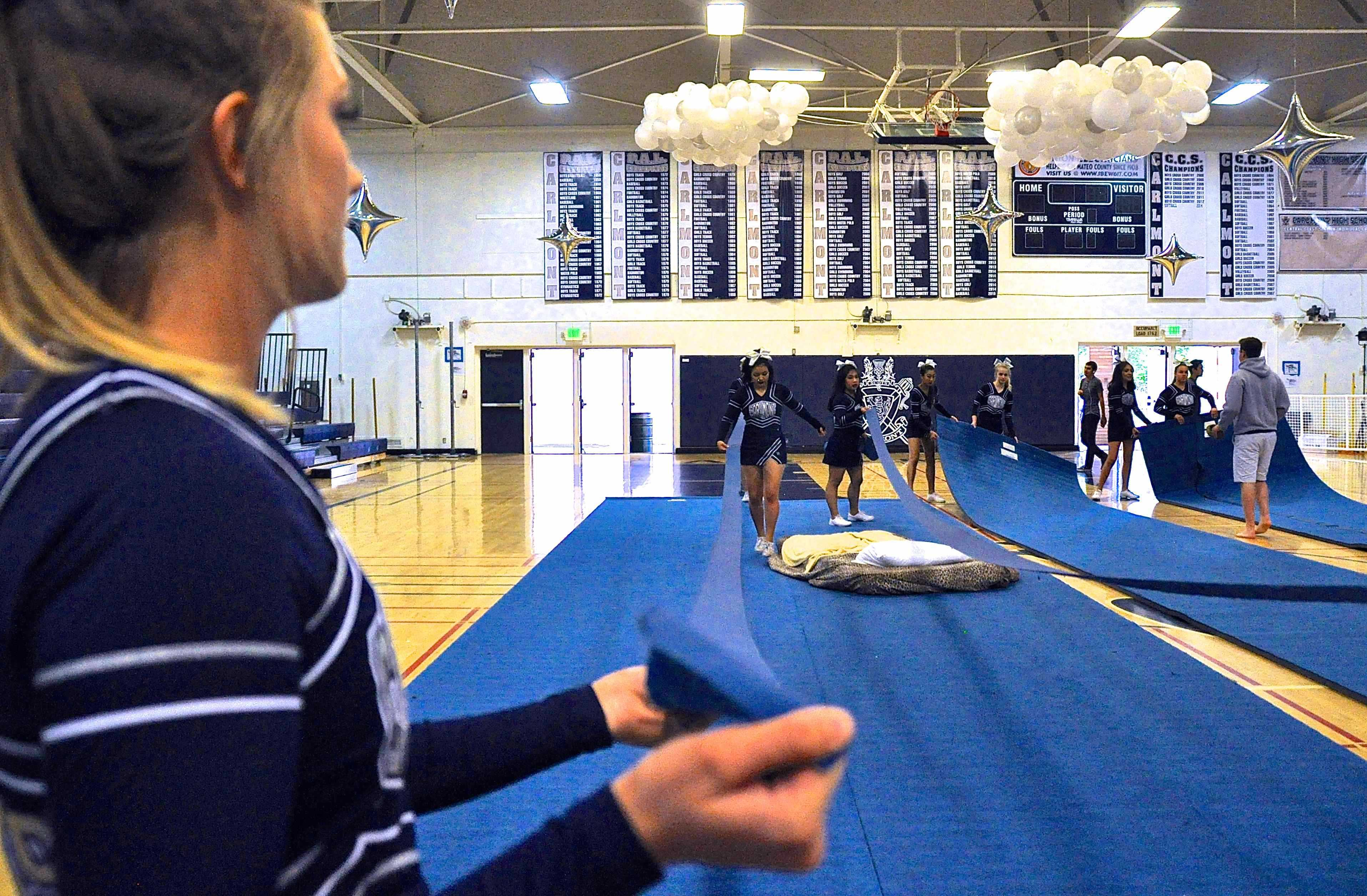 Carlmont%27s+Cheer+team+prepares+the+gym+for+their+tumbling+routine.+