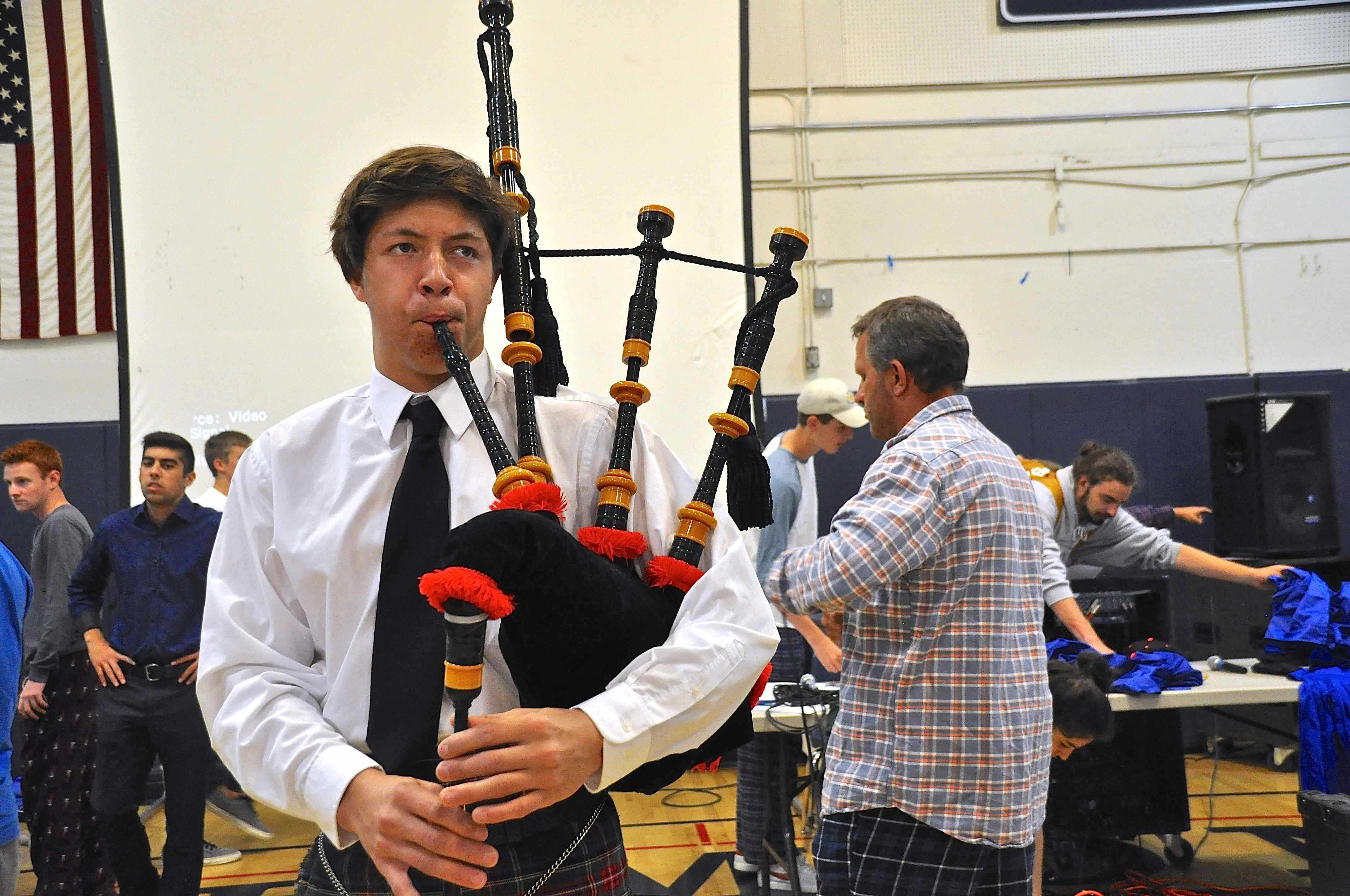 Junior+Adrian+Putes+plays+the+bagpipes+as+students+pour+into+the+gym.+