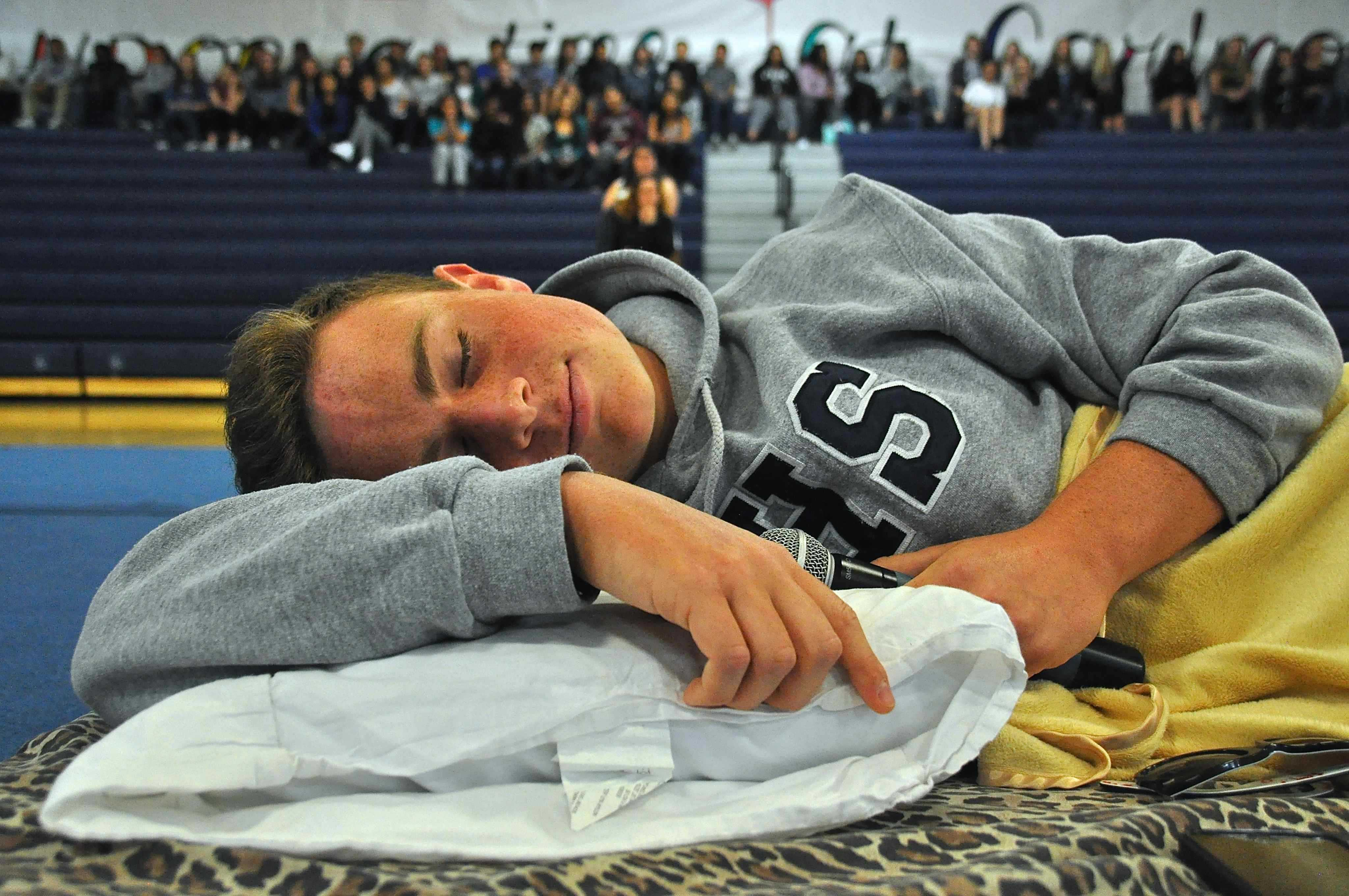 ASB+President+and+senior+Timmy+Miller+gets+into+position+for+the+assembly%27s+starting+act.+