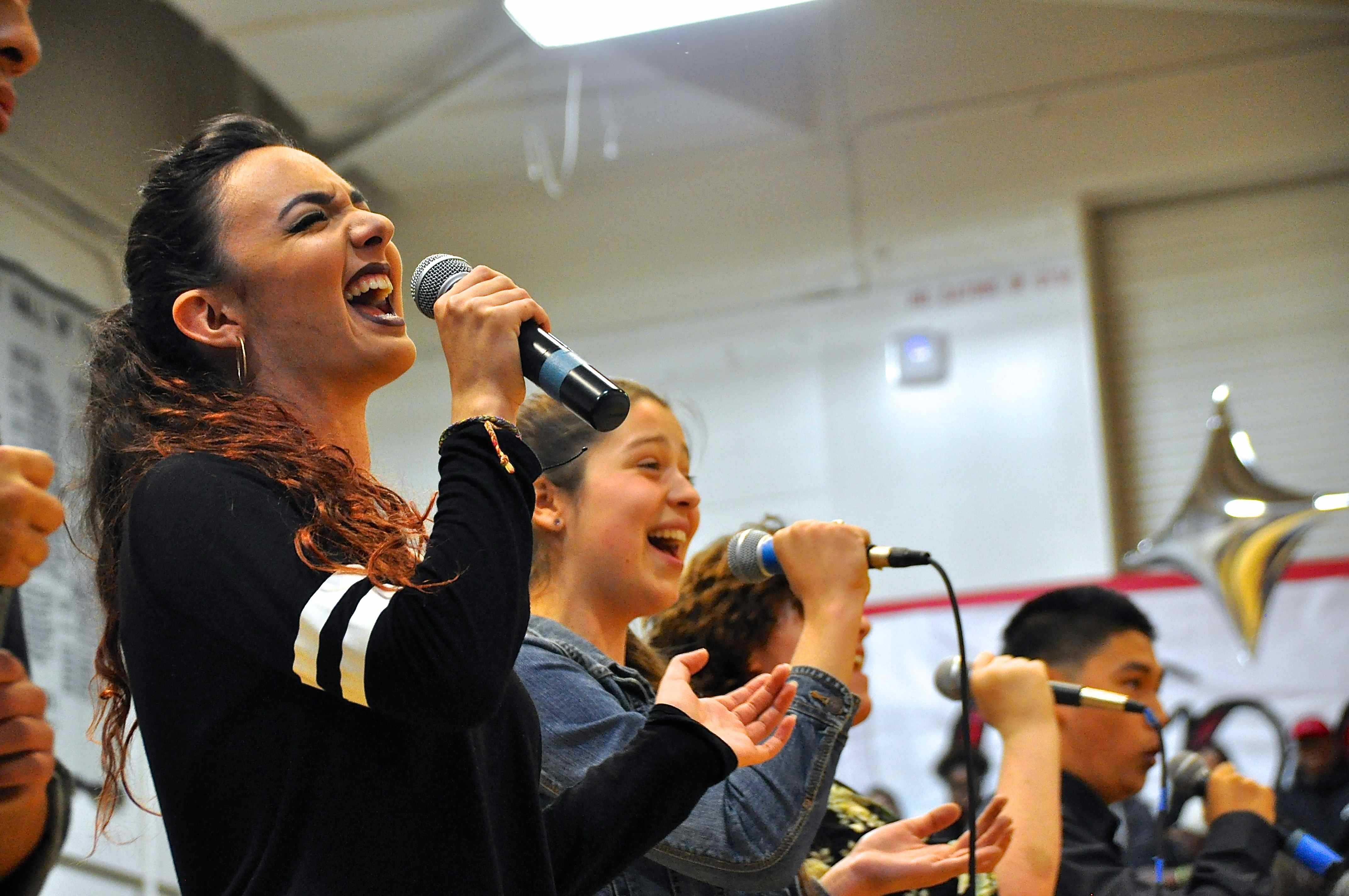 Senior+Sierra+Segal+belts+high+note+during+the+choir+performance.