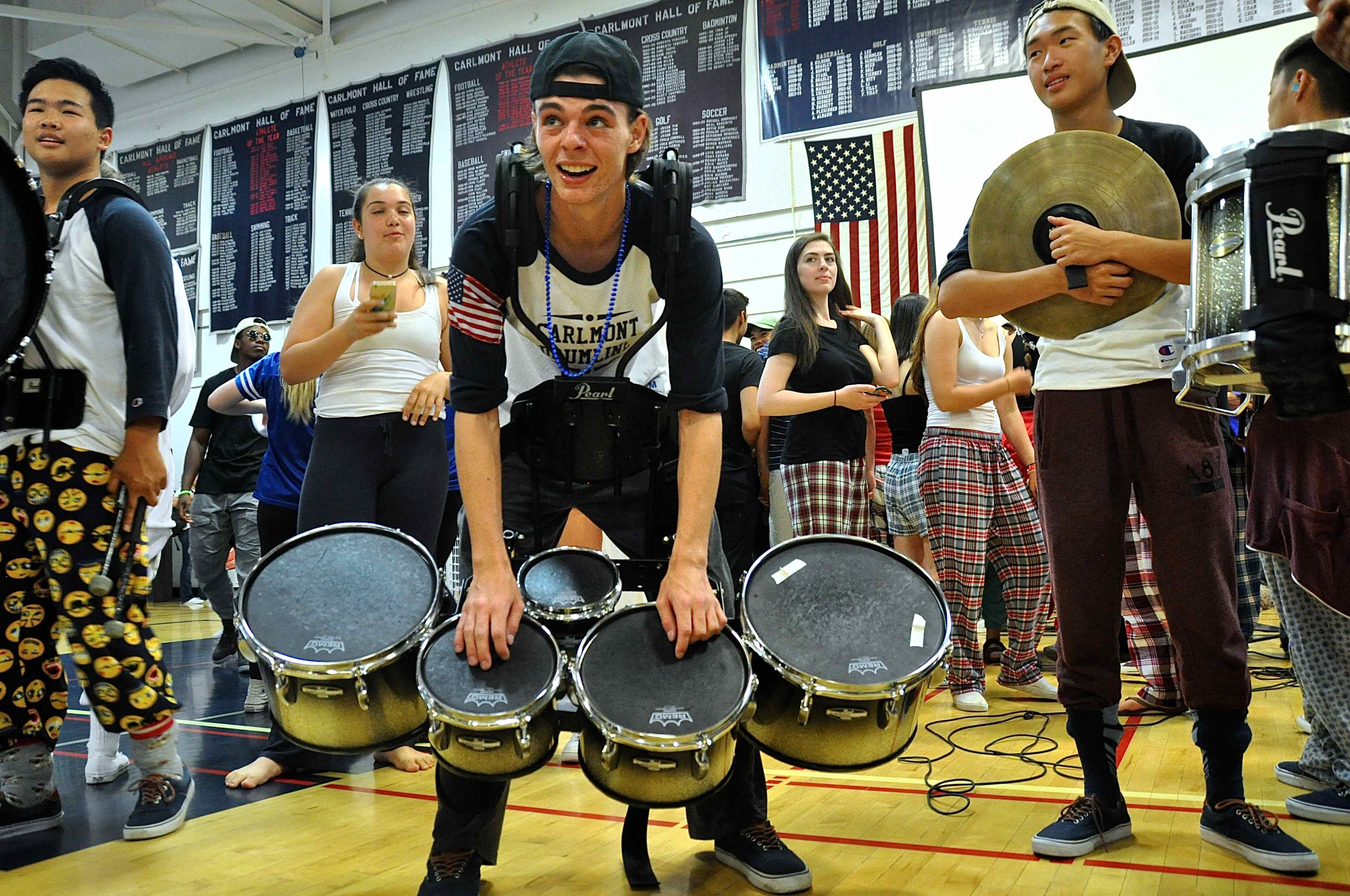 Students+crowd+Muldoon+after+his+drum+solo.+