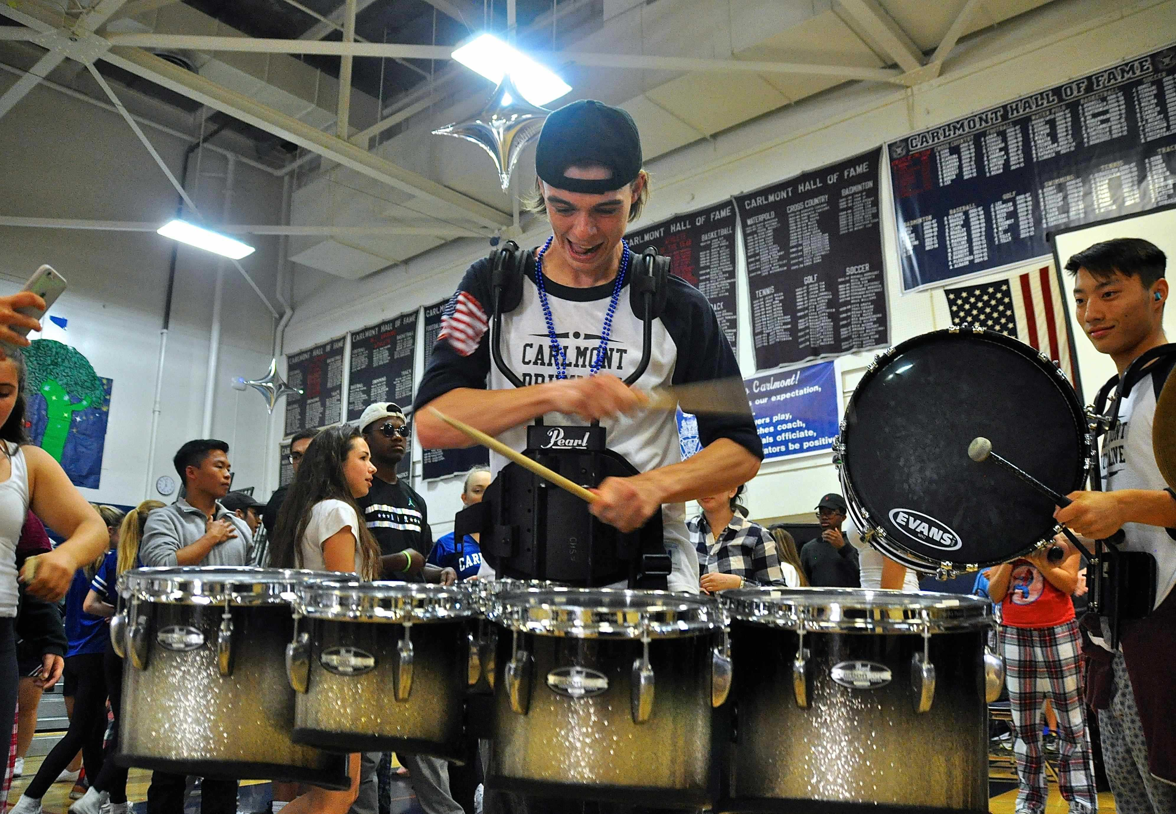 Senior+Mike+Muldoon+plays+a+solo+during+the+drumline+performance.+